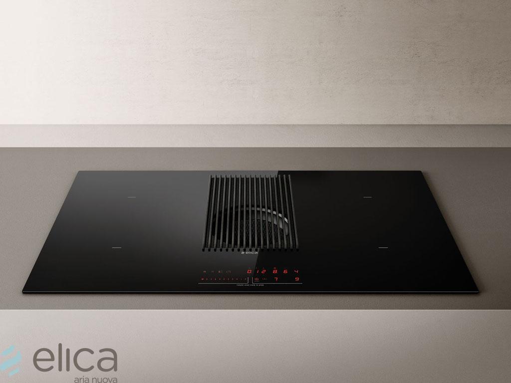 ELICA NIKOLATESLA PRIME BL/A/83 = LUCHTAFVOER-UITVOERING  De NikolaTesla is Elica's eerste inductiekookplaat met geïntegreerde afzuiging, uitgerust met de meest geavanceerde technologieën. Wat opvalt is het onderscheidende design, gekenmerkt door sterke lijnen en hoge kwaliteit materiaal. Met de NikolaTesla worden de functies van twee apparaten gecombineerd in één product. Het biedt alle voordelen van een inductiekookplaat, zoals snel koken en eenvoudige reiniging  Het afzuigsysteem, dat centraal gepositioneerd is, behaalt hoge prestaties op het gebied van afzuiging, geluidsniveau en energie-efficiëntie (klasse A+). Dankzij de directe communicatie met de kookplaat, kan het afzuigsysteem informatie van de kookzone ontvangen en hierdoor automatisch het juiste afzuigniveau instellen. Zodoende hoeft de gebruiker zich alleen zorgen te maken over het daadwerkelijke koken, terwijl het apparaat zorgt voor vermindering van het energieverbruik.  De NikolaTesla is beschikbaar in een afzuig- en filter-uitvoering, zodat deze bij elk type keukenplanning eenvoudig geïnstalleerd kan worden. Dit dankzij de beschikbare accessoires van Elica. De filter-uitvoering is uitgerust met op topniveau presterende keramische filters, die gemakkelijk vanaf het bovenste deel van de kookplaat bereikbaar zijn. Hierdoor zijn reiniging en onderhoud zeer gebruiksvriendelijk. De vetfilter en het bijbehorende rooster worden gekenmerkt door het exclusieve design, met aandacht voor elk detail.    * power limitation (3,1 - 4,5 - 7,4 KW) * timer * kookwekker * restwarmte aanduiding * temperatuur manager * kinderslot * stop and go * panherkenning  NikolaTesla Prime is de inductiekookplaat met geïntegreerde afzuiging van Elica die uniek is door de zoektocht naar een esthetisch evenwicht en door de bijzondere aandacht voor functionele details. In het midden van de glasplaat met vier onafhankelijke inductiezones valt de elegante gietijzeren grill op, die het product een professionele uitstraling geeft en het kr