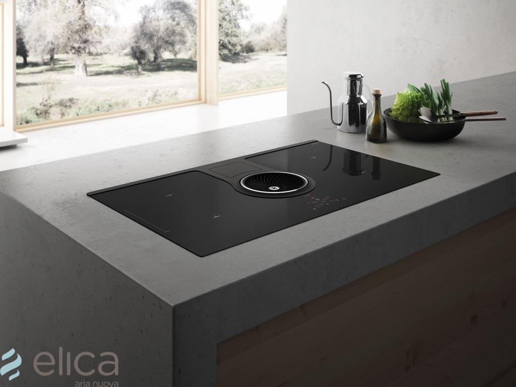 ELICA NIKOLATESLA ONE BL/A/83 LUCHTAFVOER  De NikolaTesla is Elica's eerste inductiekookplaat met geïntegreerde afzuiging, uitgerust met de meest geavanceerde technologieën. Wat opvalt is het onderscheidende design, gekenmerkt door sterke lijnen en hoge kwaliteit materiaal. Met de NikolaTesla worden de functies van twee apparaten gecombineerd in één product. Het biedt alle voordelen van een inductiekookplaat, zoals snel koken en eenvoudige reiniging. Echter, Elica heeft specifieke technologieën toegevoegd, zoals een dubbele brug functie, waardoor twee aangrenzende kookzones gecombineerd worden en geschikt is voor gebruik van grote pannen.  Het afzuigsysteem, dat centraal gepositioneerd is, behaalt hoge prestaties op het gebied van afzuiging, geluidsniveau en energie-efficiëntie (klasse A+). Dankzij de directe communicatie met de kookplaat, kan het afzuigsysteem informatie van de kookzone ontvangen en hierdoor automatisch het juiste afzuigniveau instellen. Zodoende hoeft de gebruiker zich alleen zorgen te maken over het daadwerkelijke koken, terwijl het apparaat zorgt voor vermindering van het energieverbruik.  De NikolaTesla is beschikbaar in een afzuig- en filter-uitvoering, zodat deze bij elk type keukenplanning eenvoudig geïnstalleerd kan worden. Dit dankzij de beschikbare accessoires van Elica. De filter-uitvoering is uitgerust met op topniveau presterende keramische filters, die gemakkelijk vanaf het bovenste deel van de kookplaat bereikbaar zijn. Hierdoor zijn reiniging en onderhoud zeer gebruiksvriendelijk. De vetfilter en het bijbehorende rooster worden gekenmerkt door het exclusieve design, met aandacht voor elk detail.  ELICA NIKOLATESLA ONE BL/A/83 LUCHTAFVOER  - inductiekookplaat met afzuiging in luchtafvoer-uitvoering - afmeting 830x515x210 mm  - inbouwmaat 807x492 mm, opbouw en vlakinbouw - 647 m3/h, 160W - soft touch bedienings 9 standen + booster  - aluminium vetfilter  - max. 59 db(A) - afvoeraansluiting 220x90 mm/150 mm  - 7,4 kW, 50-60 Hz, 220-240
